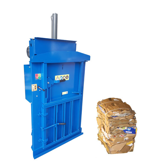 60 baler with a small bale of cardboard