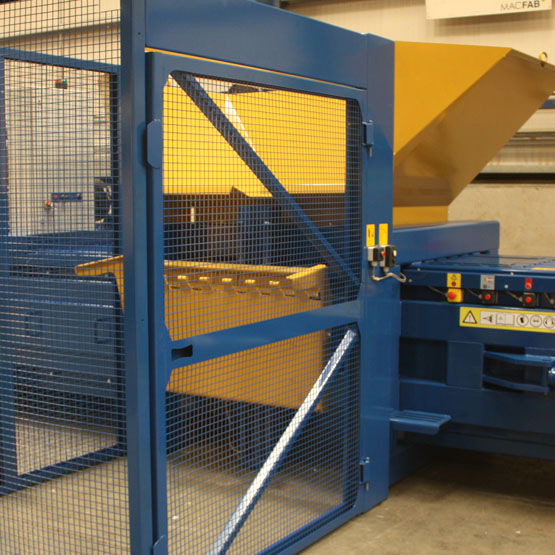 Horizontal baler with a bin lifter and safety cage